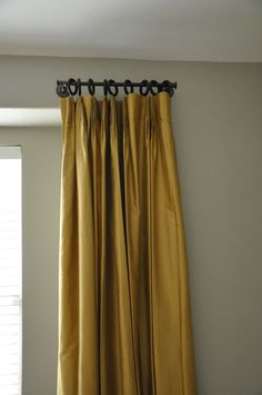 Towel bar to hang stationary draperies. Such a great money saving solution for large windows!
