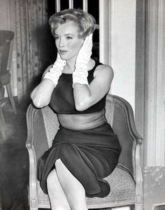 """Marilyn at a press conference for """"The Prince and The Showgirl"""" at the Savoy Hotel, London, July 1956."""