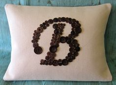 A pillow monogrammed with buttons... kind of strange, but a good gift for button people?