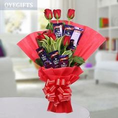Your Gift Contains: 6 Cadbury Dairy Milk Chocolate 6 Red Roses Red Paper Packaging Red Ribbon Seasonal Leaves Birthday Gift Delivery, Send Birthday Gifts, Online Birthday Gifts, Online Gifts, Send Gifts, Cadbury Dairy Milk Chocolate, Silk Chocolate, Chocolate Roses, Chocolate Bouquet