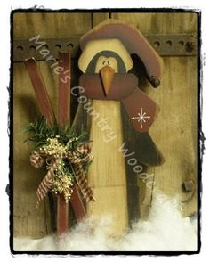 Painted Prim Wood Penguin with skis  $19.95 USD.