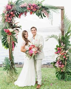 Pink and Green Flower Arch Decorations. Oceanfront Hawaii Wedding, Tropical Wedding Arch Ideas arch white A Casual Beach Wedding in Puako, Hawaii Wedding Arch Flowers, Wedding Ceremony Arch, Floral Wedding, Hawaiian Wedding Flowers, Tropical Wedding Decor, Beach Wedding Arches, Tropical Wedding Bouquets, Tropical Weddings, Wedding Receptions