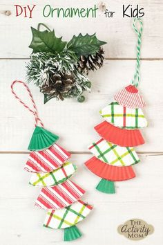 Christmas Ornament Craft for Kids. Use cupcake liners and a craft stick for this ornament kids can make. DIY Christmas ornament for kids. #christmas #kids #ornaments #christmasornaments #kidscrafts Easy Christmas Ornaments, Handmade Ornaments, Simple Christmas, Diy Christmas, Family Christmas, Xmas, Christmas Activities For Families, Traditions To Start, Craft Stick Crafts