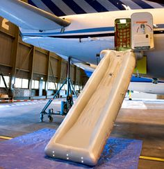 INFLATABLE ESCAPE SLIDE was developed in 1965 by Jack Grant of QANTAS. The inflatable aircraft escape slide can also be used as a raft on water. These slides are now standard safety equipment on all major airlines.
