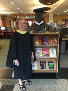 Susan Conant, Associate Director of Library Services, was the Convocation Marshall for the Platform Party yesterday. Here she stands w/ Fr. Bart! 8/16