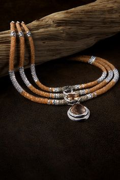 CARTIER. Necklace - white gold, one 21.13-carat cushion-shaped orange tourmaline, one cabochon-cut rutilated quartz, mandarin garnet beads, brown diamond beads, obsidian, brilliant-cut diamonds. #Cartier #L'OdyséeDeCartierParcoursD'unStyle #2013 #HauteJoaillerie #HighJewellery #FineJewelry #Mandarin Garnet #Diamond