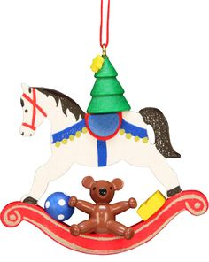 """Delightful Rocking Horse with toys and a Christmas Tree with Star Christmas Ornament. Classic wooden, matte finish, primary colors. 2-3/4"""" tall From Christian Ulbricht - handcrafted in the Erzgebirge, Germany since 1928 