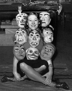 A woman with a collection of latex Mardi Gras Horror Masks , October 1938