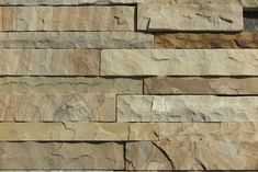 Natural cleft sandstone wall tiles for interior and exterior home walls offered by Stonemart.