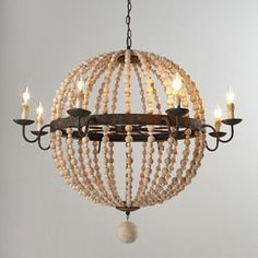 "Regina-Andrew Design - Regina-Andrew Design Wood Bead Sphere Chandelier - Sphere-shaped chandelier draped in strands of wooden beads adds rustic beauty to room lighting. Made of wood and metal. Rustic finish. Uses eight 40-watt bulbs. Direct wire; professional installation required. Ceiling canopy included. 41.5""Dia. x...."