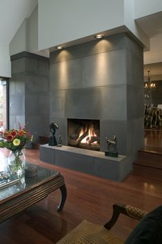 Fireplace downlighting. Cast Concrete Tiled Fireplace in Shiitake