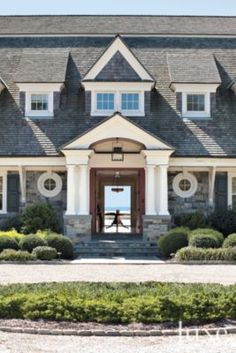 Country Stone Entrance The house incorporates a rich variety of shapes and decorative elements—from elegant mill-work, to dormers and elliptical windows.