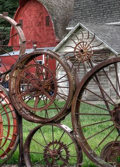 This is part of the fence made from a variety of wheels welded together which is around a field and barn. The barn has been turned into an arts and crafts place. Some beautiful watercolors and artwork were on display inside.    The Wagon Wheel Fence and Barn are located just north of Uniontown, Washington on Hwy 195.
