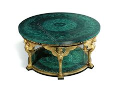 www.heuvelmans-interiors.com    AN EMPIRE STYLE ORMOLU AND MALACHITE CENTRE-TABLE   MODERN   The circular malachite-inset top with floral-cast rim, above a conforming frieze applied with alternating rosettes and anthemia, on 6 triple winged-lion monopodiae