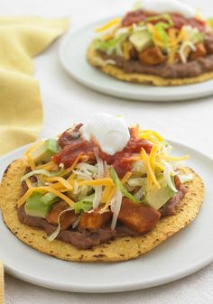 Chicken Tostadas – Mexican food-truck flavors made fresh at home. Crunchy shells with chicken and veggies, topped with cheese and sour cream!