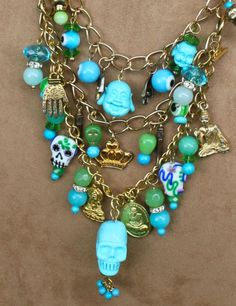 Skelton Arts' St. Barths charm necklace detail - bottom row of charms is a detachable bracelet.