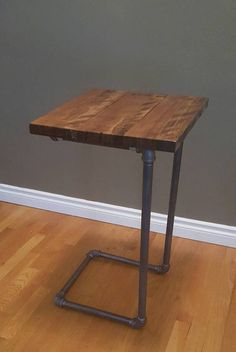 This laptop table is handcrafted lovingly from a husband and wife couple from Oregon USA. Industrial chic, but with the warmth of a Winter cabin, this Ashwood hardwood and steel piping laptop table is Industrial Chic Decor, Industrial Furniture, Rustic Decor, Industrial Pipe, Rustic Bed, Vintage Industrial, Pipe Furniture, Pallet Furniture, Furniture Design