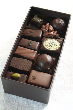 - of gourmet chocolates. (These happen to be from Henri Le Roux of Paris, France.) The very affordable Hershey and Dove chocolates are pretty wonderful, too. Chocolate World, Chocolate Dreams, Chocolate Delight, Death By Chocolate, Chocolate Sweets, I Love Chocolate, Chocolate Heaven, Chocolate Shop, Decadent Chocolate