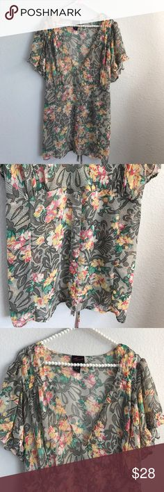 Torrid sheer floral top In excellent condition. No rips or stains. Size Torrid 2. Elastic on end of arms. Faux buttons down the front. 100% polyester. Chest 23.5 in across. torrid Tops Blouses