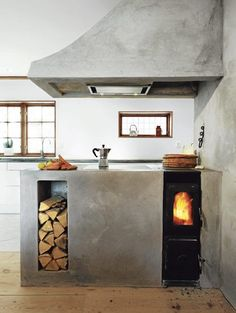 concrete hood, firewood box, and custom counters around wood-burning stove