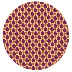 Økologisk jersey stof med dråbemønster på karrygul bund