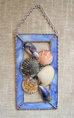 Stained Glass Seashell Window Panel by PineTreeGlassWorks on Etsy, $45.00