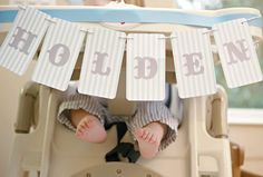 LOVE.  Must create a banner like this for baby's high chair and take a picture with little toes, just. like. this.