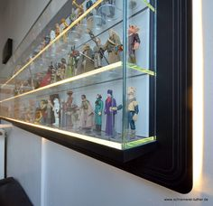 German furniture maker Schreinerei Luther made this elegant shelf for a customer who wanted to display their collection of Kenner Star Wars action figures. The shelf measures about 6ft. x 2ft. and is made of MDF and glass.