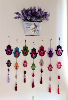 Set of 7 Unique Hamsa.Felt Wall Hanging Decor . Evil eye beads .. Set of 7 Felt wall hanging. h. 40 cm. w. 9 cm. 3 mm thick