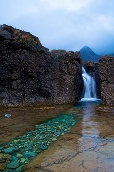 The Fairy Pools on the Isle of Syke, Scotland. The water in the pools is bright turquoise due to the mineral deposits in the rocks.