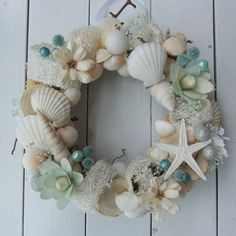would be perfect for moms house! Seashell Projects, Seashell Crafts, Coastal Wreath, Seashell Painting, Shell Art, Summer Wreath, Nautical Theme, Sea Shells, Flower Arrangements