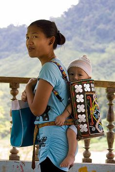 Borneo - The tribes from Borneo such as Kayan and Kenyah traditionally carry their babies in a rattan plaited carrier. These are decorated with multicolored beaded patterns of dragons, leopards and hornbills. Ancient glass beads and amulets of bear-claws or leopard's fangs add to the spiritual protection of the baby carried within.