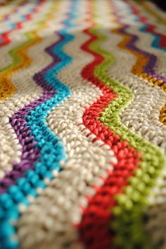 I'd learn to crochet just to make a throw like this... the colors and patterns remind me of Missoni