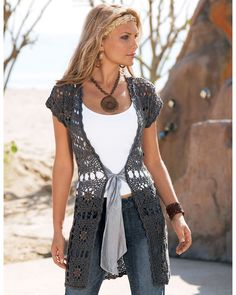 Outstanding Crochet Looks like the ribbon tie is sewn onto the front rather than being threaded thru the whole garment.