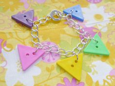 Pulling Shapes Bracelet by NiNEFRUiTSPiE on Etsy, £3.50