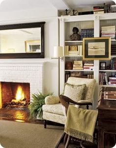 white brick fireplace and bookcases.