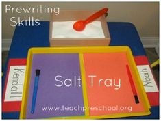Writing (and/or drawing) in a salt tray. Child chooses colour of construction paper, puts 1 scoop of salt onto paper and uses pointy end of paintbrush to practice writing.
