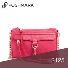 """Rebecca Minkoff Mini Mac Handbag Add a splash of color to your outfit with this cute pink Rebecca Minkoff bag! Wear it on your shoulder or crossbody with the adjustable chain strap.    DETAIL & CARE 9"""" wide x 1.5"""" deep x 6.5"""" tall Functioning front zipper pocket Adjustable chain strap can be worn cross-body (21"""" drop) or doubled (14"""" drop) Genuine leather Custom light gold hardware print lining + dust bag  NWT. A friend got it for me but I'm not a big pink person :/ cross listed. Reasonable…"""