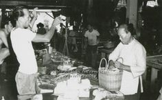 "WET MARKET - FISH SELLER USING A ""DACHING"" (WEIGHING SCALE) - 1960s"