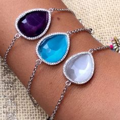 CZ Sterling silver (.925) chain with gem stone Sterling silver (925), with gem stone encircled by a CZ rim. Has loops in the back to make bigger or smaller. Please specify which color you want Adina's Jewels Jewelry Bracelets