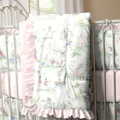 "Pink Over the Moon Toile Crib Comforter with Ruffle | Carousel Designs. Lullaby and goodnight! Our soft and cozy box-quilted comforter will keep your baby toasty warm on a chilly night, and makes for a great tummy-time mat by day. Measures approximately 36"" wide by 46"" long. Our crib comforter batting is made from recyclable hypoallergenic polyester fiberfill."