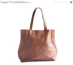 Brown leather bag Leather purse Shoulder bag Tote bag by maykobags ...u need to do is bring along your satin finished black leather tote and you are set to close the deal. It could be that your honey has asked to out for... Leather Tote Handbag will certainly be more useful on a daily basis than the average-sized purse or handbag and since it's available in three lush c #fanniehansen.com #leather-totes-brown #fashions Black Leather Tote, Brown Leather Totes, Black Tote Bag, Leather Purses, Leather Shoulder Bag, Tote Handbags, Purses And Handbags, Romantic Evening, Dooney Bourke