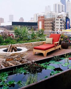 Plants and water add beauty to this rooftop space. A narrow, raised water garden provides a textural and visual contrast to plant and hardscape elements.In place of additional containers, a raised bed elevates a pretty collection of flowers.A fire pit -- either gas or wood -- is a welcome element on a balcony. It should be constructed and built out of materials that meet local fire codes.Colored gravel delivers a subtle (and soft) accent underfoot.Containers are a good option for rooftops…