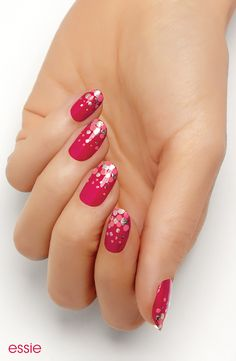 Pop! Fizz! The festive spirit of the holidays is perfectly captured on this classic red nail by essie.