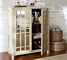 For dining room- Pottery Barn - mirrored cabinet(or wine cabinet)- there are prettier cabinets than this one with more interesting woodwork, but this is the basic idea with the woodwork and mirrors- would fit where chest is and reflect light into room and entry at TJ and home goods sell for under 249.99
