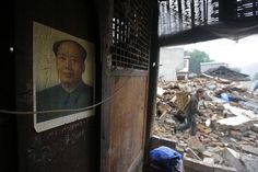 A portrait of the late Chinese Chairman Mao Zedong hangs on the wall of a damaged house after Saturday's earthquake hit Lushan county, Ya'an, Sichuan province, April 23, 2013. Hundreds of survivors of an earthquake that killed nearly 200 people in southwest China pushed into traffic on a main road on Monday, waving protest signs, demanding help and shouting at police. The earthquake killed 192 people, left 23 missing, and injured more than 11,000, state media reported. Picture taken April…