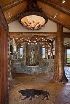Great Foyer Art Work Lighting Fixture And Custom Stone Work In The Floor Native American Decor Gorgeous Luxury Log Homes