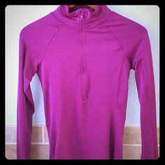 Under armor magenta zippered top Super comfortable running/exercise/whatever top! Adorable magenta color. Under Armour Tops Tees - Long Sleeve