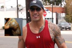 """Dwayne Johnson traveled to Hawaii to have this Samoan design inked on his shoulder. He says the tattoo """"tells the story of what's important in life - strength, protection and loyalty to family."""""""
