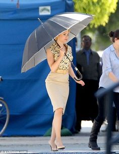 Make way: The Hollywood star carried a huge umbrella to protect herself from the sun